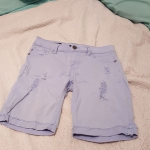 Blue ripped jean shorts